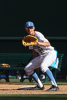 Luke Persico (21) of the UCLA Bruins waits for a throw to first base during a game against the Hofstra Pride at Jackie Robinson Stadium on March 14, 2015 in Los Angeles, California. UCLA defeated Hofstra, 18-1. (Larry Goren/Four Seam Images)