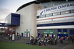 Bolton Wanderers 3 Liverpool 1, 21/01/2012. Reebok Stadium, Premier League. A brass band playing for spectators outside the home supporters end at the Reebok Stadium, before Bolton Wanderers take on Liverpool in a Barclays Premier League game. The match was won by Bolton by 3 goals to 1, watched by a near-capacity crowd of 26,854. The win lifted Bolton out of the relegation places in England's top division, while Liverpool remained seventh. Photo by Colin McPherson.