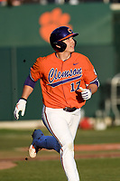 Catcher Adam Hackenberg (17) of the Clemson Tigers runs toward first in a game against the Stony Brook Seawolves on Friday, February 21, 2020, at Doug Kingsmore Stadium in Clemson, South Carolina. Clemson won, 2-0. (Tom Priddy/Four Seam Images)