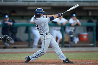 Mitch Gallagher (12) of the Xavier Musketeers follows through on his swing against the Penn State Nittany Lions at Coleman Field at the USA Baseball National Training Center on February 25, 2017 in Cary, North Carolina. The Musketeers defeated the Nittany Lions 7-5 in game two of a double header. (Brian Westerholt/Four Seam Images)