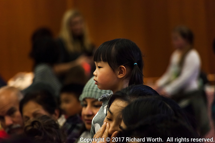 A young audience member watches performers during an event celebrating the Lunar New Year.
