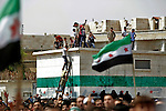 "Residents from the northern Syrian town of Al Bab organized a peaceful protest at a main square renamed after the revolution began as ""Freedom Square"". Thousands of people gathered to sing and chant anti-Assad slogans - minutes later, the square emptied as the sound of a fighter jet from the Assad air force began to circle over the city. As the people scattered, a blast was heard followed by three other explosions. The fighter jet made at least 6 passes as it fired its 50 caliber  machine gun on the neighborhood below. Doctors at the local underground hospital did not allow this reporter access to the facility because of the load of patients coming in. Unconfirmed reports by the FSA spokesperson in Kilis say that 7 people died and 50 were injured. ..Photo: Javier Manzano / August 31, 2012"