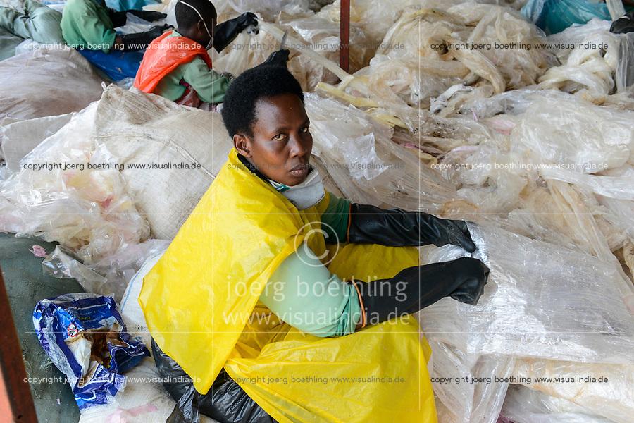 RWANDA, Kigali, plastic recycling at company ecoplastics, worker sort, clean and dry plastic foils before processing to granulate which is used for new plastic products / RUANDA, Kigali, plastic recycling bei Firma Ecoplastics, Sortierung, Reinigung und Trocknung von alten Folien bevor sie zu Granulat recycelt werden