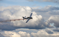 Silver T-28A Trojan US Fighter Aircraft flying through clouds, Arlington Fly-In 2016, WA, USA.