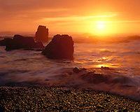 Sunset light on sea stacks and the Pacific Ocean at Crescent Beach; Ecola State Park, OR