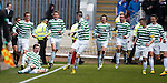 Paul McMullan celebrates his penalty for Celtic