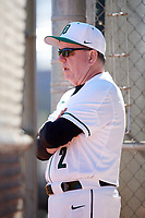 Dartmouth Big Green head coach Bob Whalen (2) in the dugout during a game against the Villanova Wildcats on March 3, 2018 at North Charlotte Regional Park in Port Charlotte, Florida.  Dartmouth defeated Villanova 12-7.  (Mike Janes/Four Seam Images)