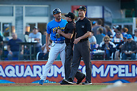 Home plate umpire Jake Bruner gets in between Myrtle Beach Pelicans manager Steve Lerud (39) and base umpire Mark Bass during the game against the Winston-Salem Dash at TicketReturn.com Field on May 16, 2019 in Myrtle Beach, South Carolina. The Dash defeated the Pelicans 6-0. (Brian Westerholt/Four Seam Images)