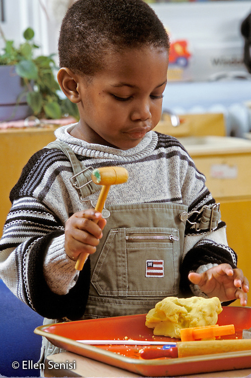 MR / Schenectady, NY.Yates Arts Magnet School - Pre-K.Boy (4, African-American) plays with clay at free time..MR: Fen1.PN#: 29043                      FC#: 20910-00507.scan from slide.©Ellen B. Senisi