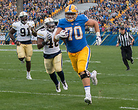 Pitt offensive lineman Brian O'Neill scores on a24-yard touchdown run from a backwards pass. The Pitt Panthers defeated the Georgia Tech Yellow Jackets 37-34 at Heinz Field in Pittsburgh, Pennsylvania on October 08, 2016.