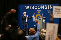 Wisconsin Gubenatorial  candidate Tony Evers walks onto the stage at a Democratic campaign rally before the midterm elections in October 2018.