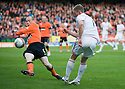 Aberdeen claim for a penalty after Aberdeen's Chris Clark's shot seems to hit the arm 0f United's Willo Flood   ...