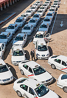 Taxi cabs await passangers at the Madrid Atocha train station, Madrid, Spain
