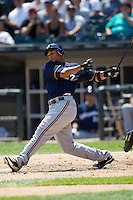 Milwaukee Brewers outfielder Carlos Gomez #27 swings during the Major League Baseball game against the Chicago White Sox on June 24, 2012 at US Cellular Field in Chicago, Illinois. The White Sox defeated the Brewers 1-0 in 10 innings. (Andrew Woolley/Four Seam Images).