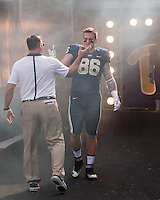 Pitt head coach Pat Narduzzi and senior tight end JP Holtz shake hands before the game. The Miami Hurricanes football team defeated the Pitt Panthers 29-24 on  Friday, November 27, 2015 at Heinz Field, Pittsburgh, Pennsylvania.
