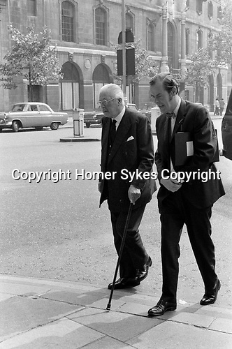 Harold Macmillan, and ? 1970 Whitehall London Uk.<br /> Maurice Harold Macmillan, 1st Earl of Stockton, British Conservative politician and  Prime Minister  from 10 January 1957 to October 1963.<br /> If you know the name of his colleague please let me know.