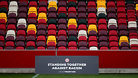 A large sign by the side of the pitch with a message, Standing Together Against Racism during Brentford vs Birmingham City, Sky Bet EFL Championship Football at the Brentford Community Stadium on 6th April 2021