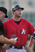 Kannapolis Intimidators manager Cole Armstrong (33) meets with Asheville Tourists manager Warren Schaeffer (not pictured) and home plate umpire Chris Padgett prior to the start of the South Atlantic League game at Kannapolis Intimidators Stadium on May 26, 2016 in Kannapolis, North Carolina.  The Tourists defeated the Intimidators 9-6 in 11 innings.  (Brian Westerholt/Four Seam Images)