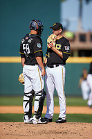Pittsburgh Pirates relief pitcher Daniel Hudson (41) talks with catcher Jacob Stallings (58) on the mound during a Spring Training game against the Tampa Bay Rays on March 10, 2017 at LECOM Park in Bradenton, Florida.  Pittsburgh defeated New York 4-1.  (Mike Janes/Four Seam Images)