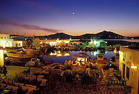 Paros, Greek Islands, Naoussa, Cyclades, Greece, Europe, Outdoor café on the waterfront on Naoussa Harbor in the evening on Paros Island on the Aegean Sea.