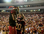 Florida State wide receiver Tamorrion Terry thumps his chest while wide receiver Keyshawn Helton helps celebrate Tammorrion's 74 yard touchdown catch for the win late in the second half of an NCAA college football game in Tallahassee, Fla., Saturday, Nov. 17, 2018. Florida State defeated Boston College 22-21.  (AP Photo/Mark Wallheiser)
