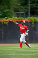 Yoansy Moreno (12) throws from the outfield during the Dominican Prospect League Elite Underclass International Series, powered by Baseball Factory, on July 21, 2018 at Schaumburg Boomers Stadium in Schaumburg, Illinois.  (Mike Janes/Four Seam Images)
