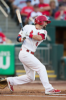 Adam Melker (4) of the Springfield Cardinals follows through his swing after making contact on a pitch during a game against the Northwest Arkansas Naturals at Hammons Field on August 23, 2013 in Springfield, Missouri. (David Welker/Four Seam Images)