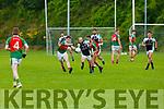 Kieran Slattery Legion sprints past Sean O'Leary and Danny Cronin Kilcummin during their SFC game in Lewis Road  Killarney Saturday evening