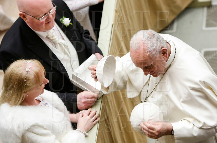 Pope Francis exchanges his skull cap with one donated by faithful during his weekly general audience in the Paul VI hall at the Vatican, January 22, 2020.<br /> UPDATE IMAGES PRESS/Riccardo De Luca<br /> STRICTLY ONLY FOR EDITORIAL USE