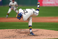 Steve Hajjar (27) of the Michigan Wolverines follows through after delivering a pitch in a game against the Purdue Boilermakers on Friday, March 12, 2021, at Fluor Field at the West End in Greenville, South Carolina. (Tom Priddy/Four Seam Images)