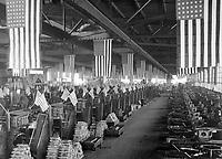 "Interior view of projectile shop #1, machining 3"" shells.  Bethlehem Steel Company, Bethlehem, Pa.   Ca. 1918.   Bethlehem Steel Co.  (War Dept.)<br />Exact Date Shot Unknown<br />NARA FILE #:  165-WW-350-5A<br />WAR & CONFLICT BOOK #:  556"