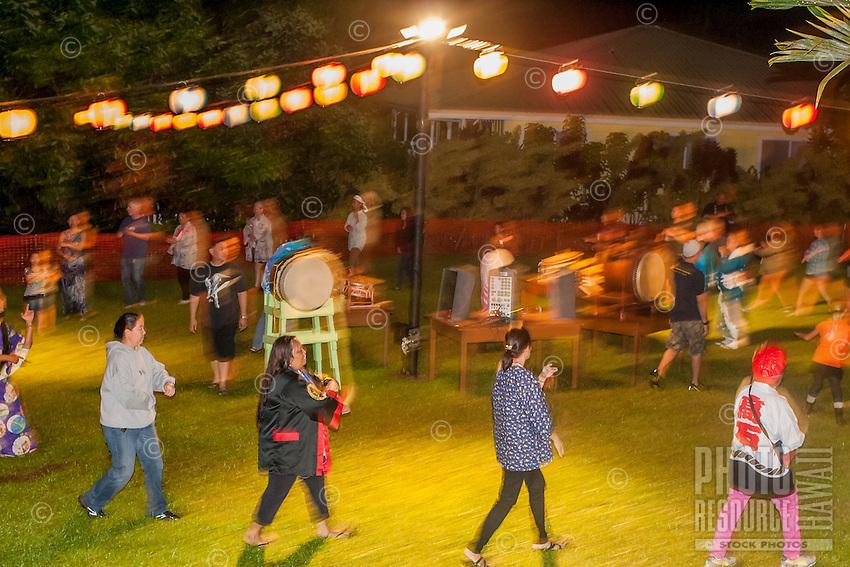 The community dances together at Hakalau Jodo Mission Bon Dance, Big Island of Hawai'i 2014, where local families come each year to celebrate their ancestors.