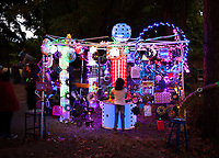 Girl Playing at Magical Light Art Installation, Arts-A-Glow Festival, Dottie Harper Park, Burien, WA, USA.