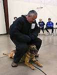 Volunteer Bruce Huff, Carson City Sheriff's Deputy Jimmy Surratt and his K-9 partner Ary demonstrate patrol skills for a group of GATE students from Carson Middle and Eagle Valley Middle schools, on Wednesday, March 5, 2014 at Fuji Park.<br /> Photo by Cathleen Allison/Nevada Photo Source