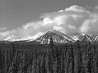 """""""View Along the Alaska Highway""""<br /> Yukon Territory, Canada <br /> <br /> The Alaska Highway begins in Dawson Creek, British Columbia and passes through the Yukon Territory before arriving at its destination almost 1,400 miles later near Fairbanks, Alaska. Scenery along the highway is spectacular. These mountain peaks near Teslin in the Yukon were a good subject for black and white photography."""