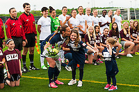Sky Blue FC defender Christie Rampone (3) receives flowers from her daughters Rylie and Reece before the match. Sky Blue FC defeated the Seattle Reign FC 2-0 during a National Women's Soccer League (NWSL) match at Yurcak Field in Piscataway, NJ, on May 11, 2013.