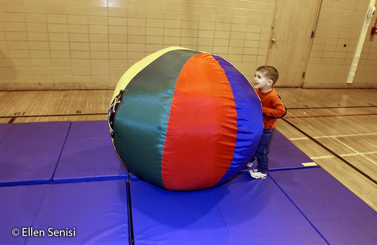 MR / Schenectady, NY                                  .Yates Arts-in-Education Magnet School (urban school).Pre-Kindergarten class; NYS Universal Pre-K Program.Boy (4) pushes big ball in gym class..Pre1.©Ellen B. Senisi