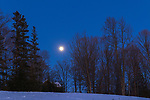 A full moon rising over a home in northern Wisconsin.