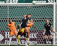Washington Freedom  defender Cat  Whitehill  (4) heads away the ball to defend her goal against Sky Blue forward Natasha Kai (6).  Washington Freedom defeated Skyblue FC 2-1  at RFK Stadium, Saturday May 23, 2009.