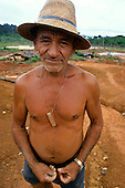 Ouro Verde, Brazil. Carimpeiro - illegal gold miner wearing a hat.