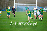 Kerry's Caoimhe Spillane goes on a solo run as Meaths Meave Clince gives chase in the Camogie Intermediate Championship