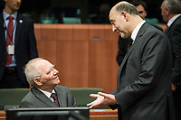 Wolfgang Schauble, German Federal Minister of Finance (L) talks with Pierre Moscovici , EU commissioner for Economic and financial affairs, taxation and customs union  at the start of a Eurogroup with European Finance Ministers meeting at EU council headquarters in Brussels, Belgium on 26.01.2015 The Eurogroup's meeting focus on Greece, after  leftist anti-bailout party SYRIZA won parliamentary elections by Wiktor Dabkowski