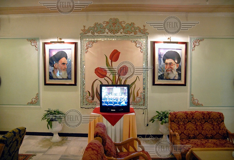 Portraits of Ayatollah Khomeini and Khameini in the lobby of the Suite Hotel.
