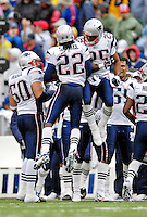 22 October 2006: New England Patriots cornerback Asante Samuel (22) and cornerback Artrell Hawkins (25) celebrate a scoring play during a game against the Buffalo Bills at Ralph Wilson Stadium in Orchard Park, NY. The Patriots defeated the Bills 28-6. Mandatory Photo Credit: Ed Wolfstein Photo.<br />