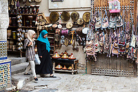 Fes, Morocco.  Moroccan Women Walking through the Place Nejjarine in the Medina, Fes El-Bali.