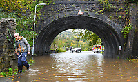 Flooding effected the villages of Aberdulais and Tonna in the Neath Valley after Storm Callum brought heavy rain and wind to the area cuasing the River Neath to reach bursting point.<br /> A man walks through flood water in Tonna. Saturday 13 October 2018
