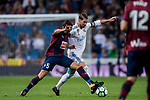 Gonzalo Escalante (l) of SD Eibar competes for the ball with Sergio Ramos of Real Madrid during the La Liga 2017-18 match between Real Madrid and SD Eibar at Estadio Santiago Bernabeu on 22 October 2017 in Madrid, Spain. Photo by Diego Gonzalez / Power Sport Images