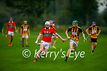 Crotta's Tadhg McKenna on a solo run as  Abbeydorney's   Jedd Maunsell keeps tracking him, in the County Hurling league Div 3 final