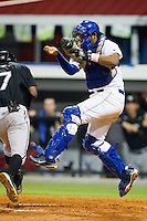 Edul Escobar #11 of the Burlington Royals leaps to catch a high throw as Marcus Spencer #7 of the Bristol White Sox scores the eventual winning run at Burlington Athletic Stadium August 13, 2010, in Burlington, North Carolina.  Photo by Brian Westerholt / Four Seam Images
