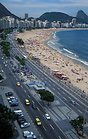 Copacabana Beach and Avenida Atlantica, with Sugar Loaf in background in late afternoon, Rio de Janeiro, Brazi